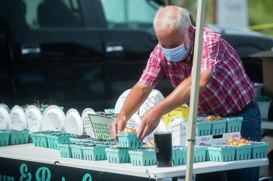 Wednesday, July 29: The Midland Area Farmers Market is currently operating as a walking market at the Dow Diamond East Parking Lot from 7 a.m. to 1 p.m. on Wednesdays and Saturdays. (Daily News file photo)