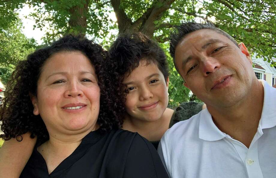 The Velásquez family of Stamford, from left, Mónica, Amilcar and Adelaida were among the recipients of the special Help-a-Neighbor campaign created to assist area residents struggling economically during the pandemic. Photo: Contributed Photo