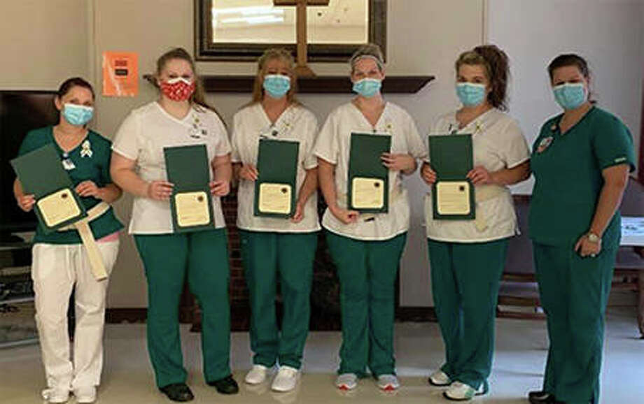 Five John Wood Community College students received their pins during a ceremony at the Barry Community Care Center: Kelsey Sherfy (from left), Jenna Kelley, Lesa Holder, Makayla Perry, Shelby Hulett and instructor Laura Mathews. Photo: Photo Provided