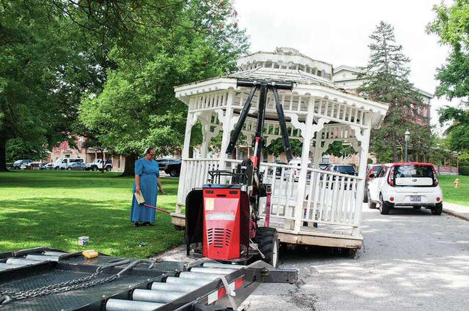 Fannie Graber (left) helps Aden Graber of Lincoln Land Transport load the Ron Sipek Gazebo at Illinois School for the Deaf. The gazebo — named for Sipek, who was quarterback for the school's 9-0 team in 1969 — has been moved to the Jacksonville Community Center for the Deaf. Photo: Darren Iozia | Journal-Courier