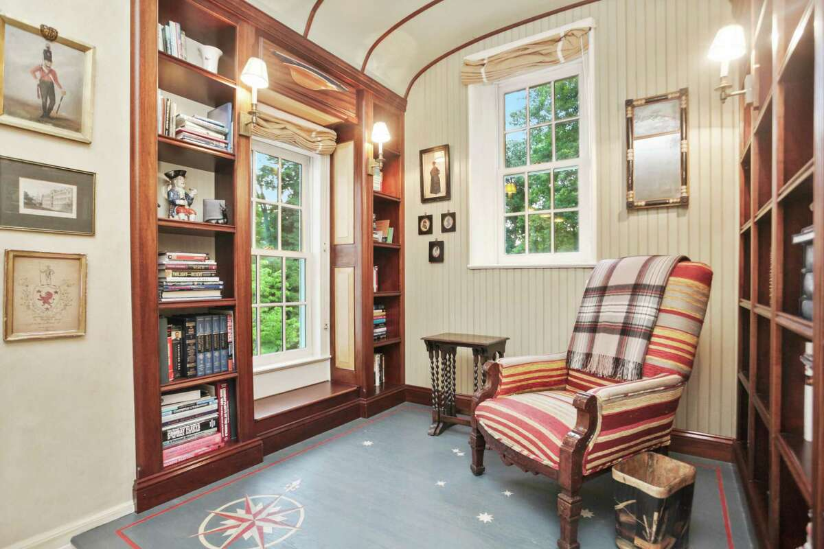 The Pre-War colonial at 26 Deer Park Drive - in the private Deer Park Association - is currently listed for $6.45 million by Sotheby's International Realty. The six-bedroom house has 8,586 square feet of living space, including a classic paneled library on the main level and a cozy reading nook upstairs.