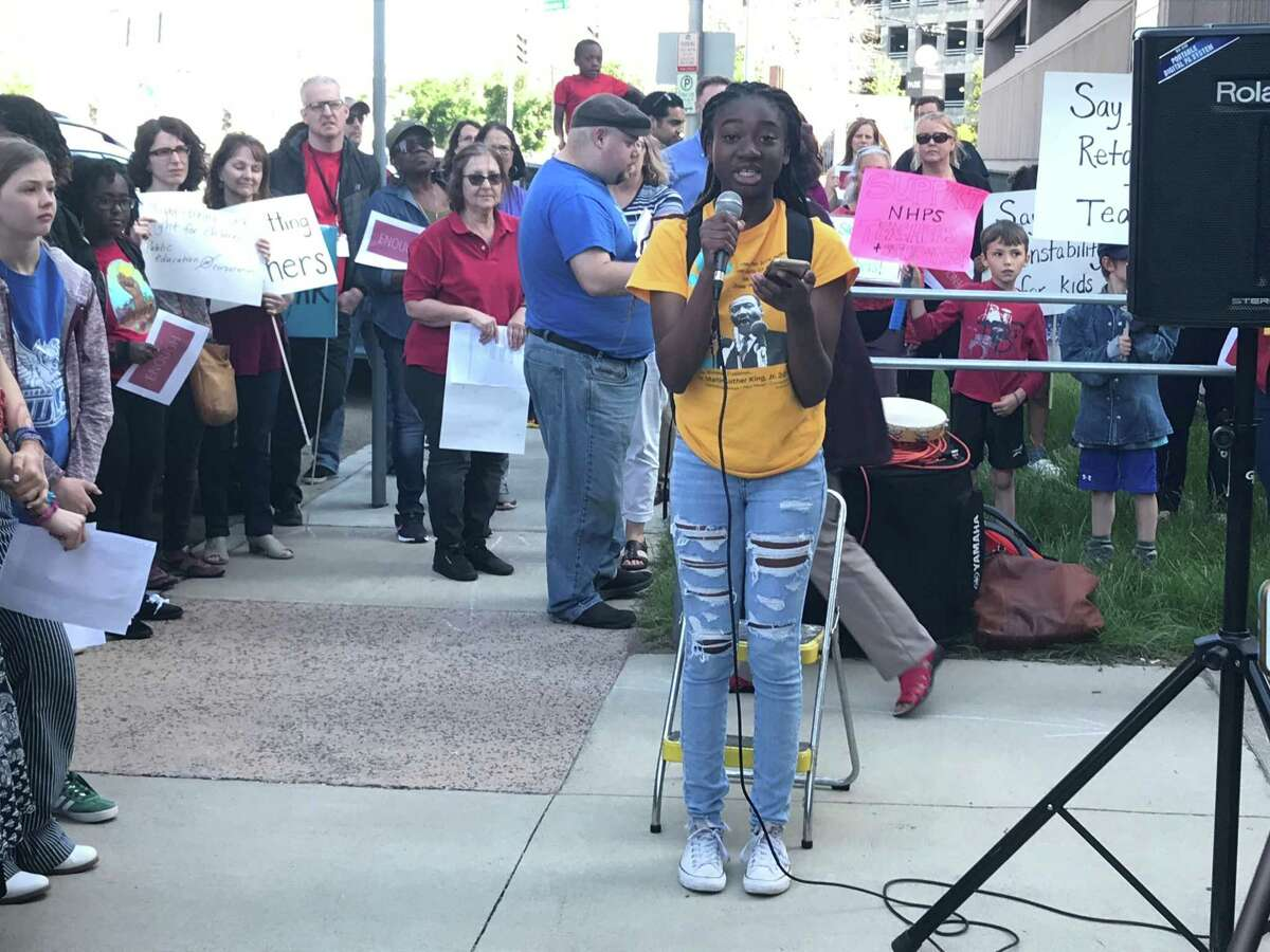 Student member-elect of the Board of Education Lihame Arouna speaks at a June 3, 2019 rally in support of the 53 teachers who learned their jobs would be eliminated from the district last week.