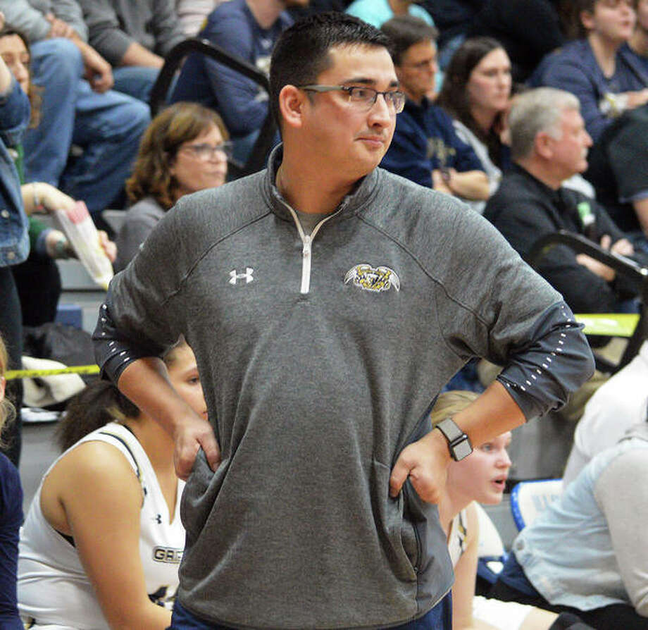 Father McGivney coach Jeff Oller looks to the court during a game from the Griffins' 27-8 finish that brought Class 1A regional and sectional championships. Oller is 2020 Telegraph Small-Schools Girls Basketball Coach of the Year. Photo: Matt Kamp / Hearst Illinois