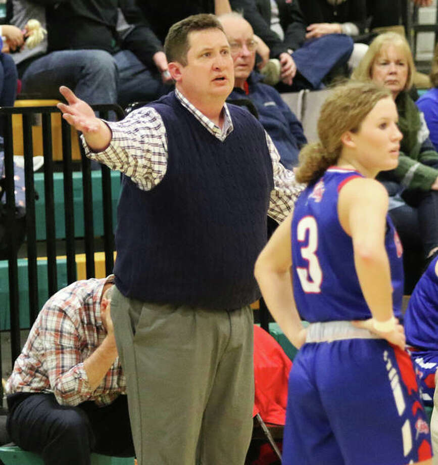 Carlinville coach Darrin DeNeve looks for clarification from a referee while the Cavaliers' Eryn Sea (3) waits for word during a SCC game at Southwestern last season in Piasa. DeNeve, who guided the Cavs to a 28-4 season, is a 2020 Telegraph Small-Schools Girls Basketball Coach of the Year. Photo: Greg Shashack / The Telegraph