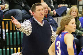 Carlinville coach Darrin DeNeve looks for clarification from a referee while the Cavaliers' Eryn Sea (3) waits for word during a SCC game at Southwestern last season in Piasa. DeNeve, who guided the Cavs to a 28-4 season, is a 2020 Telegraph Small-Schools Girls Basketball Coach of the Year.