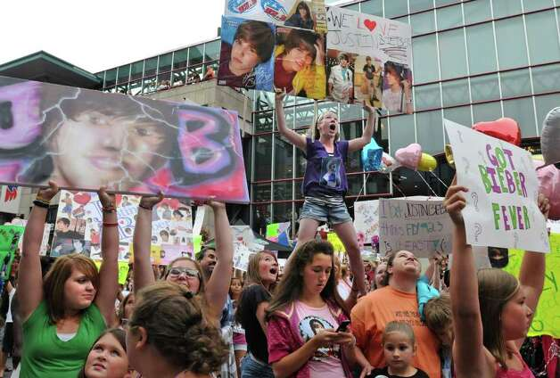 "Sarah Spiro, age 13 of Slingerlands, is lifted above the crowd as she holds up the sign she made in hopes of winning ""the best sign"" contest in front of the Times Union Center before seeing  Justin Bieber in Albany, NY on August 25, 2010. The radio station FLY 92.3 was giving away upgraded seats for the best sign. (Lori Van Buren / Times Union) Photo: Lori Van Buren"