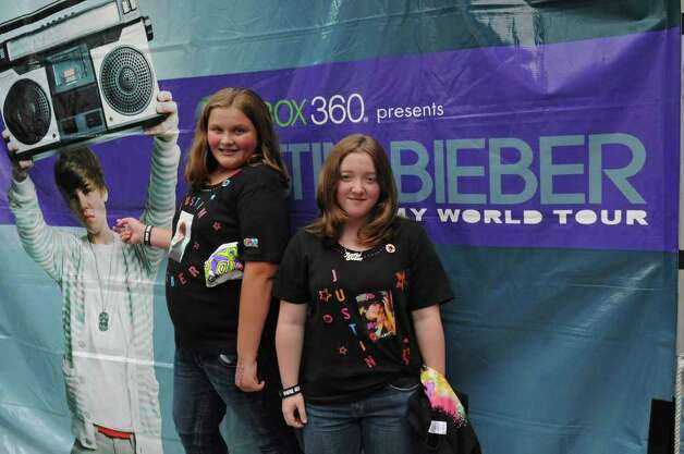 Fans Mariah Hess, age 11 of Lacona, NY, and her friend Hannah Woolson, age 11, of Orwell, NY, stand by a banner before seeing Justin Bieber at the Times Union Center in Albany, NY on August 25, 2010. (Lori Van Buren / Times Union) Photo: Lori Van Buren