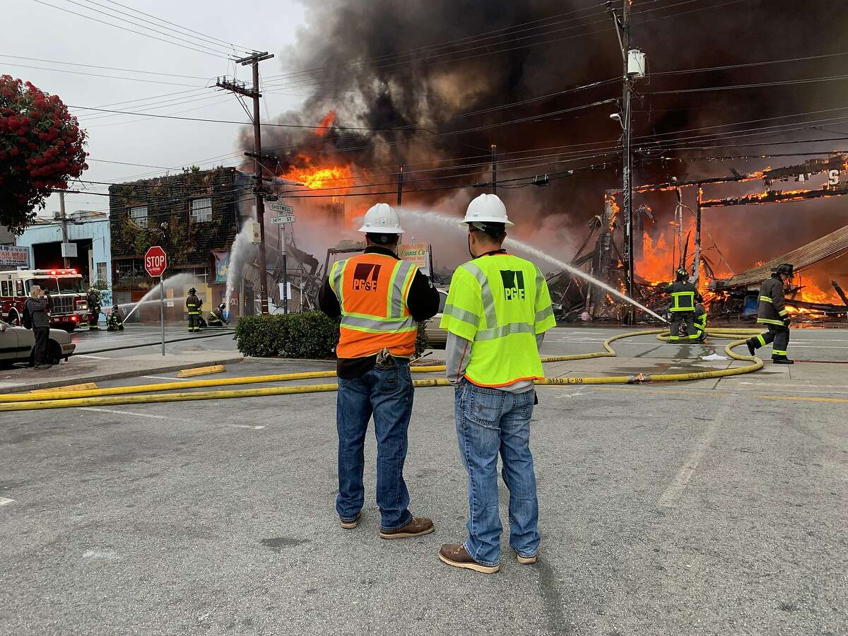 A four alarm fire burns near 14th and Shotwell streets on Tuesday, July 28, 2020 in ,