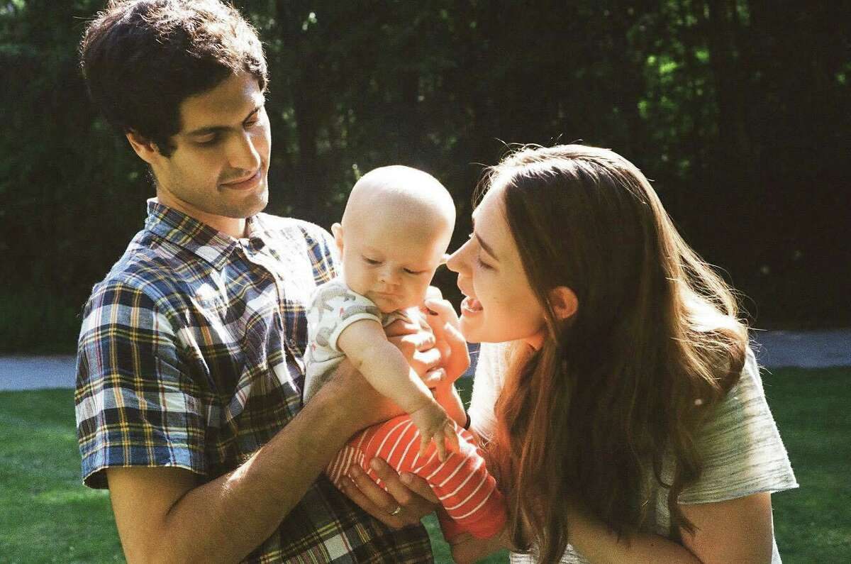 """New Haven author Emily Adrian with her husband Dan and their son Wes. Emily was inspired to write her novel """"Everything Here Is Under Control"""" after having her son Wes three years ago."""