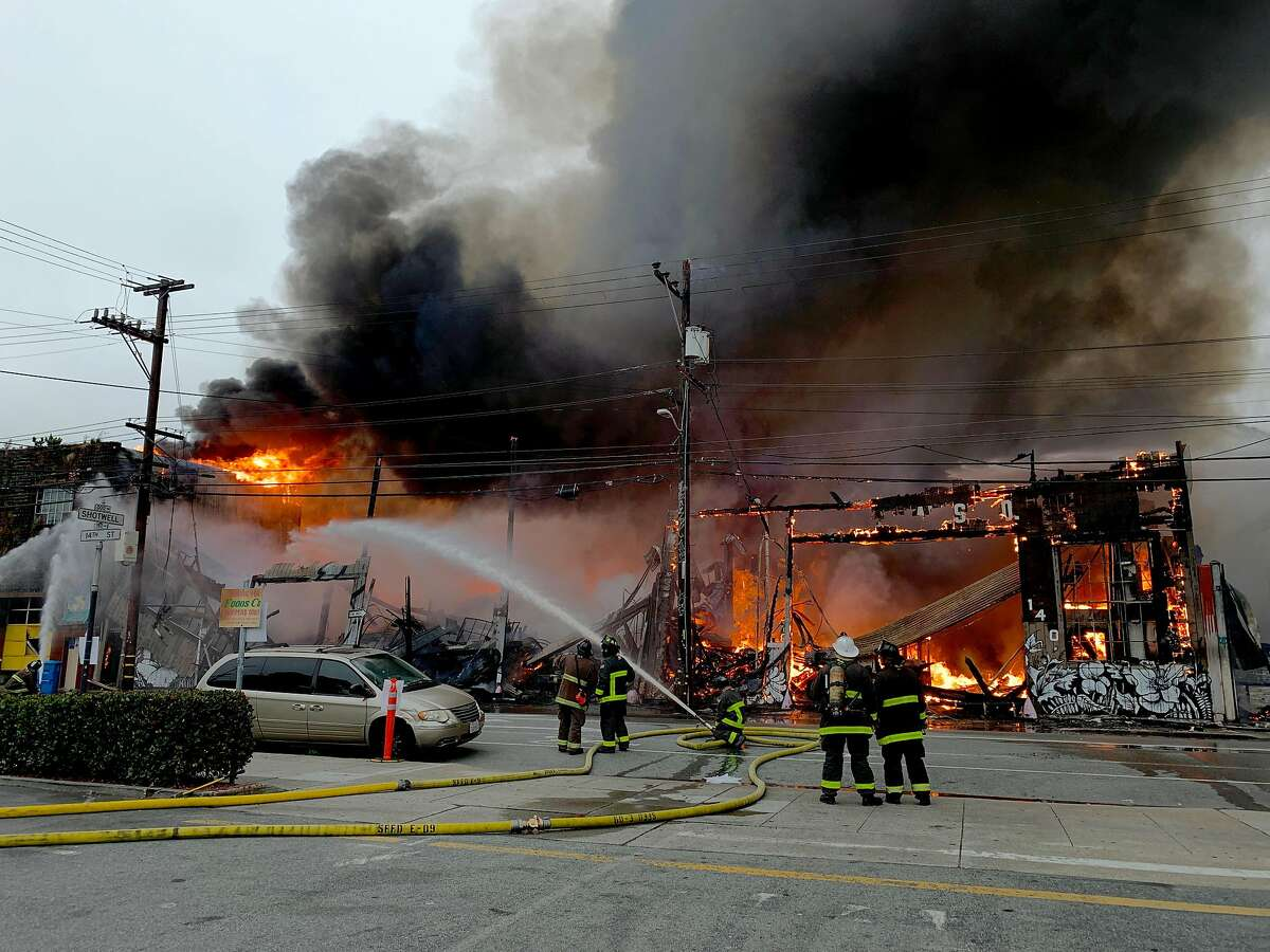 A four alarm fire burns near 14th and Shotwell streets on Tuesday, July 28, 2020 in San Francisco, Calif.