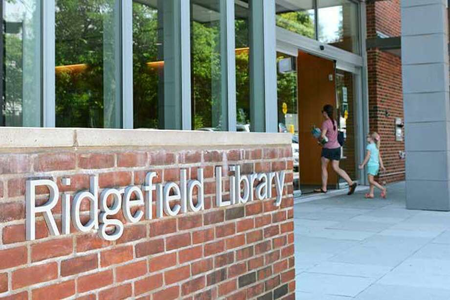 The Ridgefield library plans to reopen it's doors to the public, with special rules to mitigate the risks of spreading the coronavirus. Photo: Steve Coulter / Hearst Connecticut Media