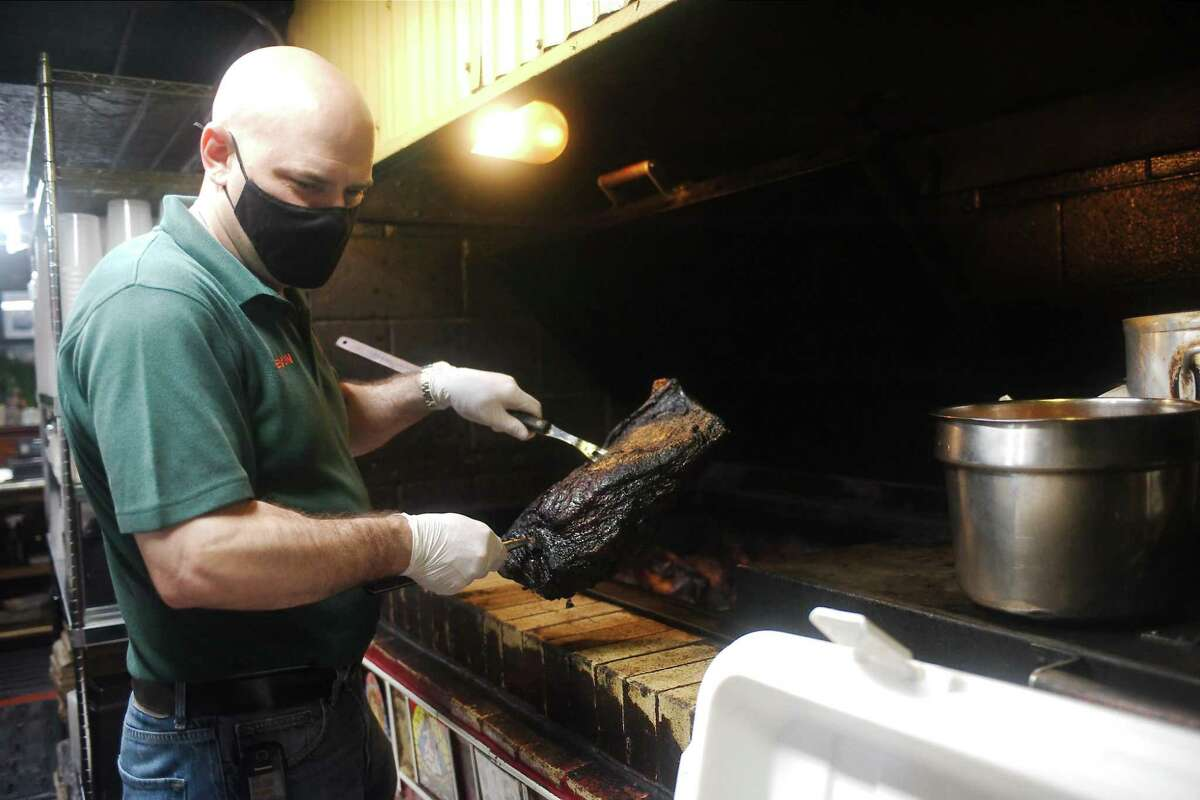 Nixon removes a beef brisket from one of the pits.