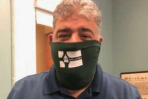 New Milford Mayor Pete Bass wears one of the masks his office is selling to raise money to purchase more PPE for seniors in town.