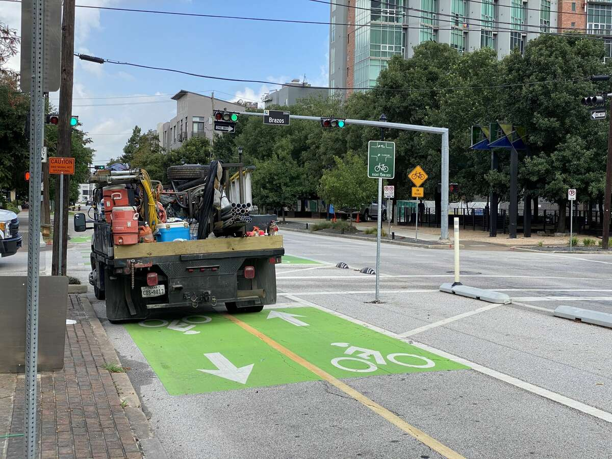 Green means go, for parking? A truck belonging to a contractor working on traffic signals blocks the designated bike lane on Gray Street near Brazos Street on Tuesday, July 28, 2020.