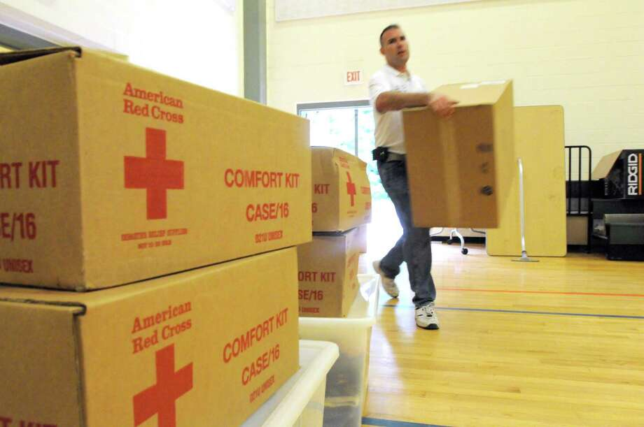 In preparation of Superstorm Irene in 2011, Michael Ranieri of the New Haven Red Cross bring supplies for expected evacuees into the Red Cross Emergency Shelter at the Benjamin Jepson School gymnasium in New Haven. Photo: Peter Hvizdak / Hearst Connecticut Media File Photo