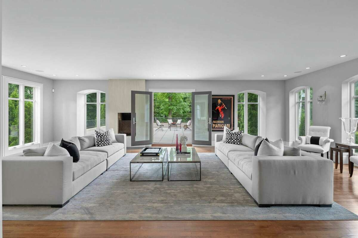 In the sizable living room there are French doors that provide access to an elevated stone terrace.