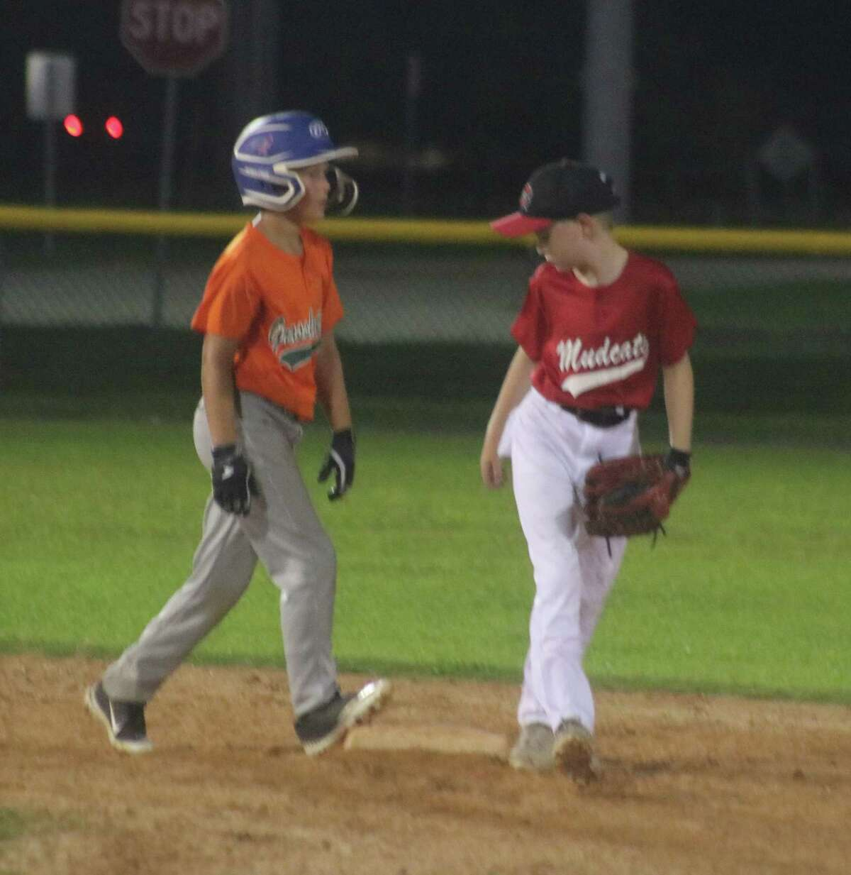 The Mudcats second baseman patrols near the bag, making sure this Grasshopper runner stays on the bag Monday night.
