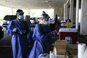 Healthcare workers prepare to test people at a Covid-19 testing site in St. Petersburg, Fla., on July 14, 2020.