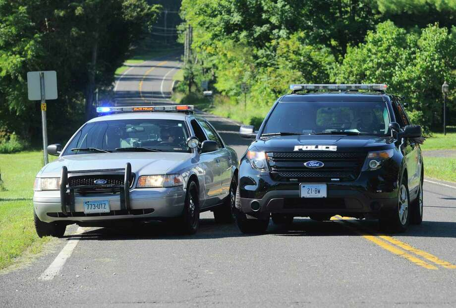 A state trooper and local police in Bridgewater, Conn. Photo: H John Voorhees III / Hearst Connecticut Media / The News-Times