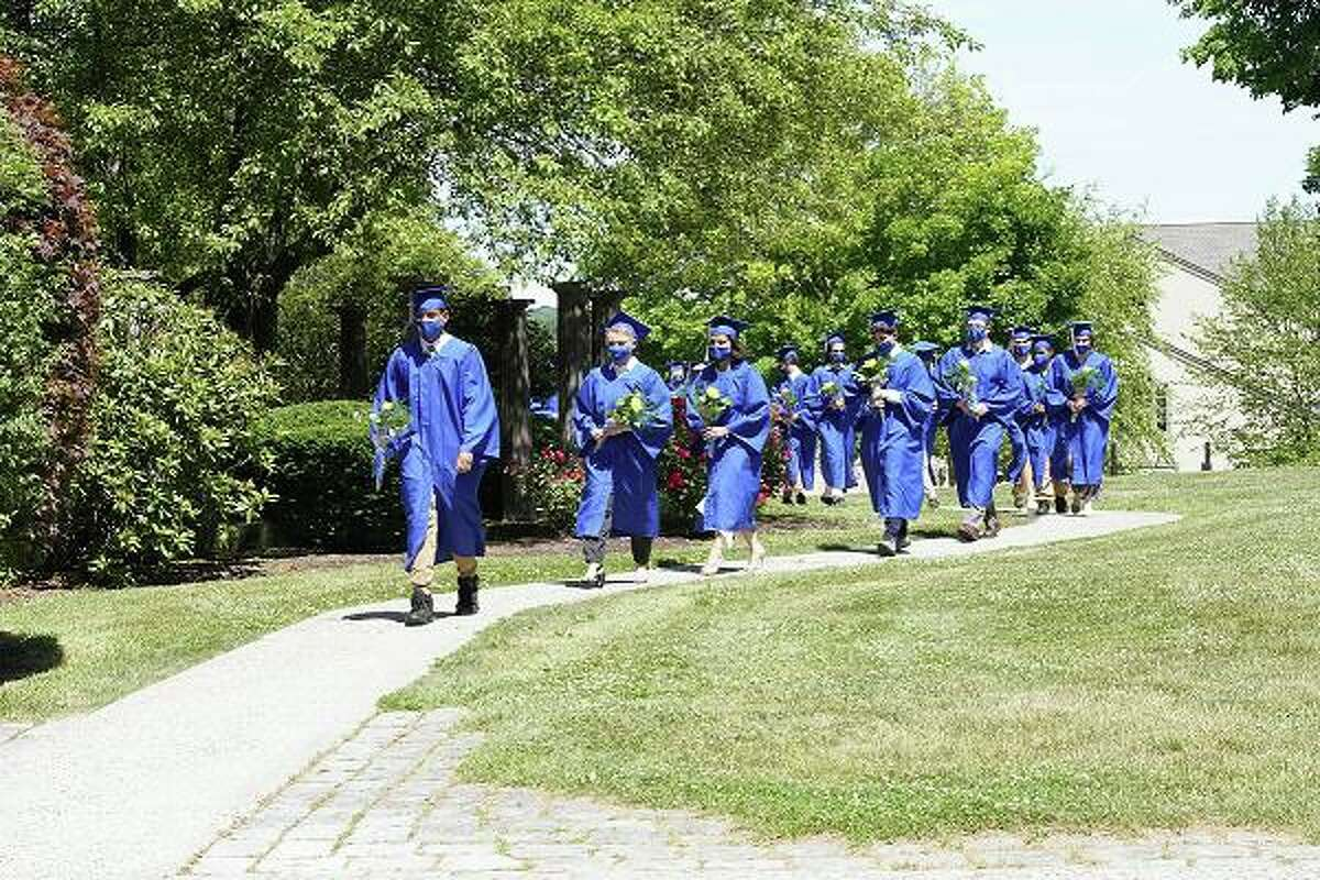 Students at Glenholme School in Washington walk in procession as part of the school's recent commencement exercises.