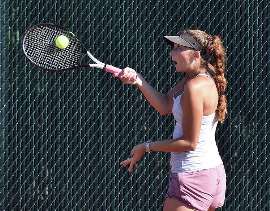 Edwardsville's Kayla Kohlberg hits a shot during practice on Tuesday morning at the EHS Tennis Facility. Photo: Matt Kamp|The Intelligencer