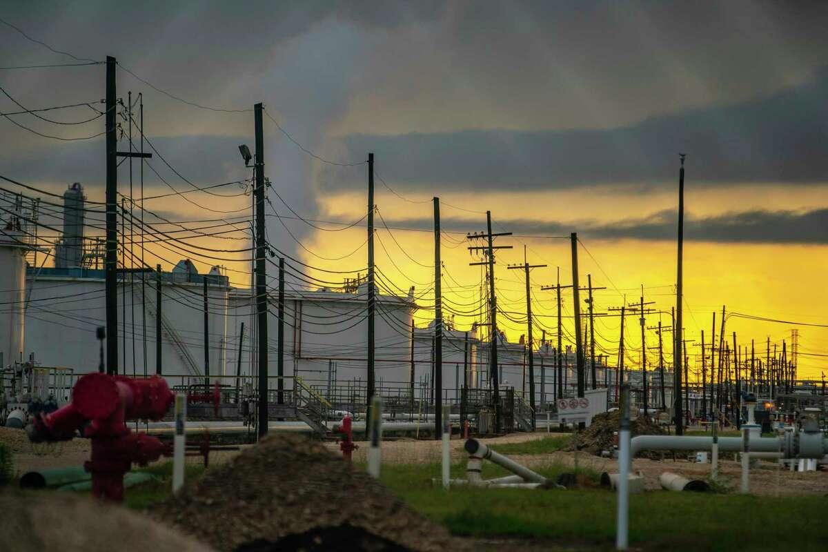 Oil storage tanks sit along Texas 225, Friday, May 15, 2020, between Houston and Pasadena.