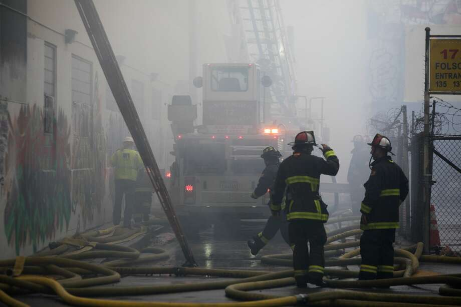The San Francisco Fire Department responded to a five-alarm fire in San Francisco's South of Market neighborhood near the Central Freeway on July 28, 2020. Photo: Douglas Zimmerman/SFGATE / SFGATE