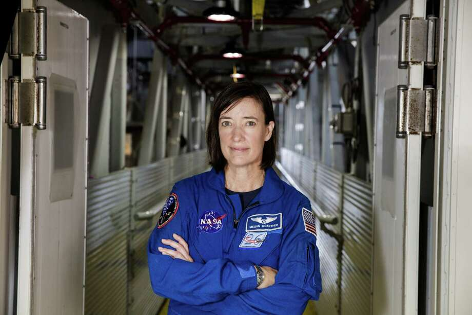 NASA astronaut Megan McArthur poses for a portrait on the Crew Access Arm of the mobile launcher, Tuesday, June 25, 2019, inside the Vehicle Assembly Building at NASA's Kennedy Space Center in Florida. Photo: NASA/Joel Kowsky