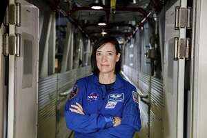 NASA astronaut Megan McArthur poses for a portrait on the Crew Access Arm of the mobile launcher, Tuesday, June 25, 2019, inside the Vehicle Assembly Building at NASA's Kennedy Space Center in Florida.