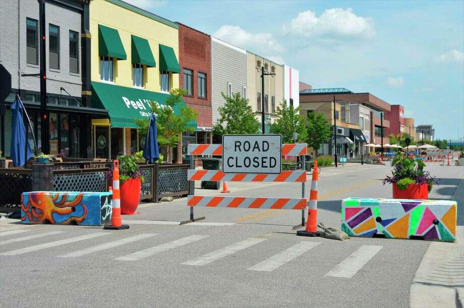 Painted barricades and road signs physically close off two blocks of Main Street in downtown Midland -- between Ashman and Rodd streets -- as a way to allow businesses to expand and allow for room to social distance on July 26, 2020. (Ashley Schafer/ashley.schafer@hearstnp.com)