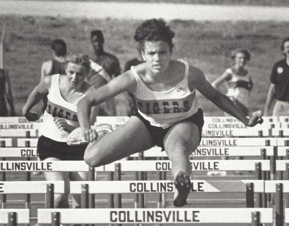 Edwardsville's Christina Perozzi competes in the 100-meter high hurdles during a meet in Collinsville. Perozzi, a 1990 EHS graduate, was a two-time Class AA state champion in the 300-meter low hurdles.