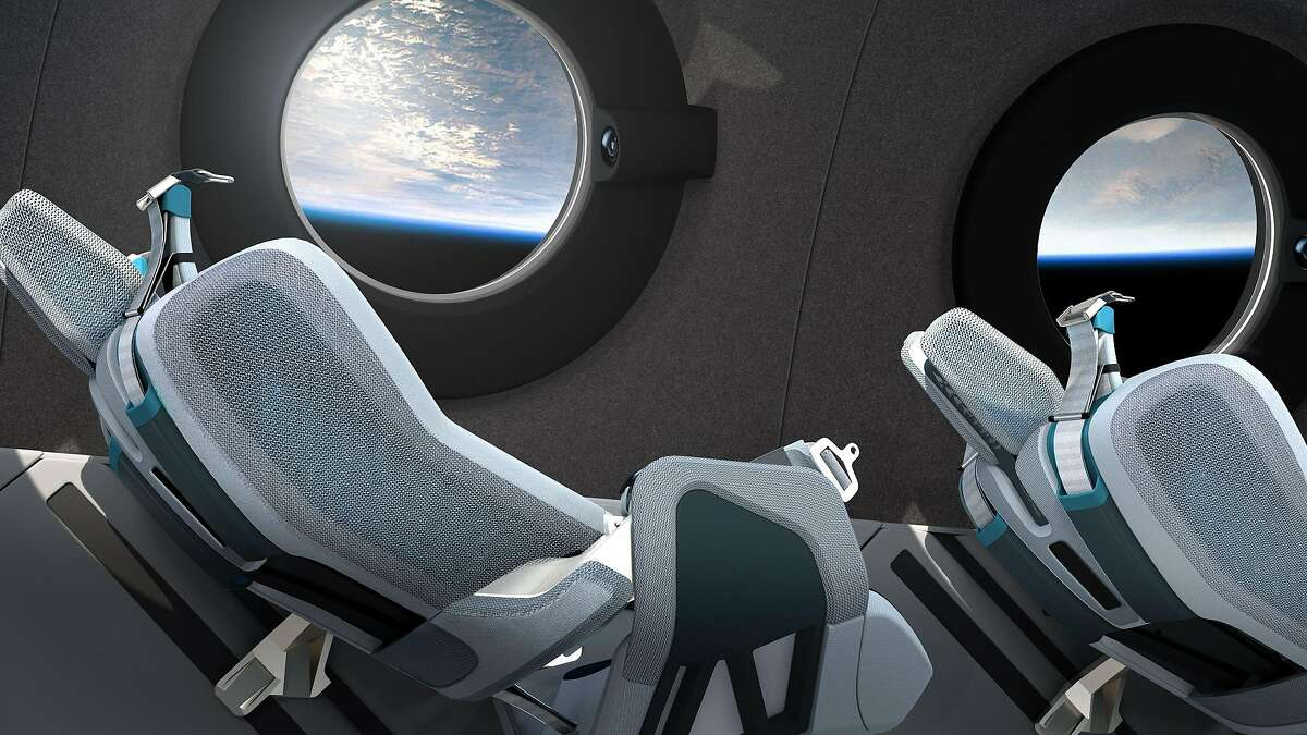 Image courtesy of Virgin Galactic obtained July 28, 2020 shows the Virgin Galactic spaceship cabin design and seats. - Virgin Galactic revealed the cabin interior of its first SpaceshipTwo vehicle, VSS Unity in a virtual livestreamed event on Tuesday. Each seat has been engineered to match the dynamism of the flight. A pilot-controlled recline mechanism, optimally positions astronauts to manage G- forces on boost and re-entry and frees up cabin space to maximize an unrestricted astronaut float zone when in zero gravity. (Photo by Handout / Virgin Galactic/The Spaceship Company / AFP) / -----EDITORS NOTE --- RESTRICTED TO EDITORIAL USE - MANDATORY CREDIT