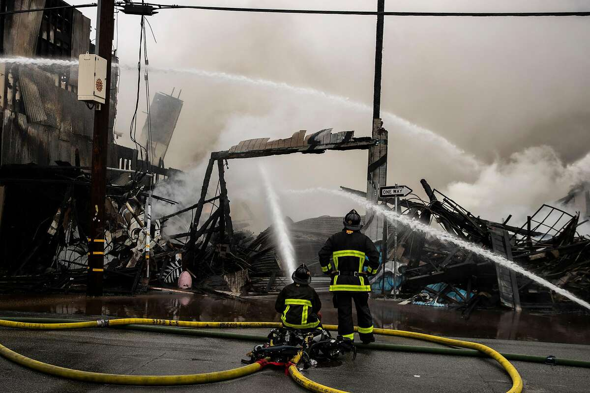 Firefighters battle a five-alarm structure fire in the South of Market neighborhood in San Francisco, Calif. on Tuesday, July 28, 2020.