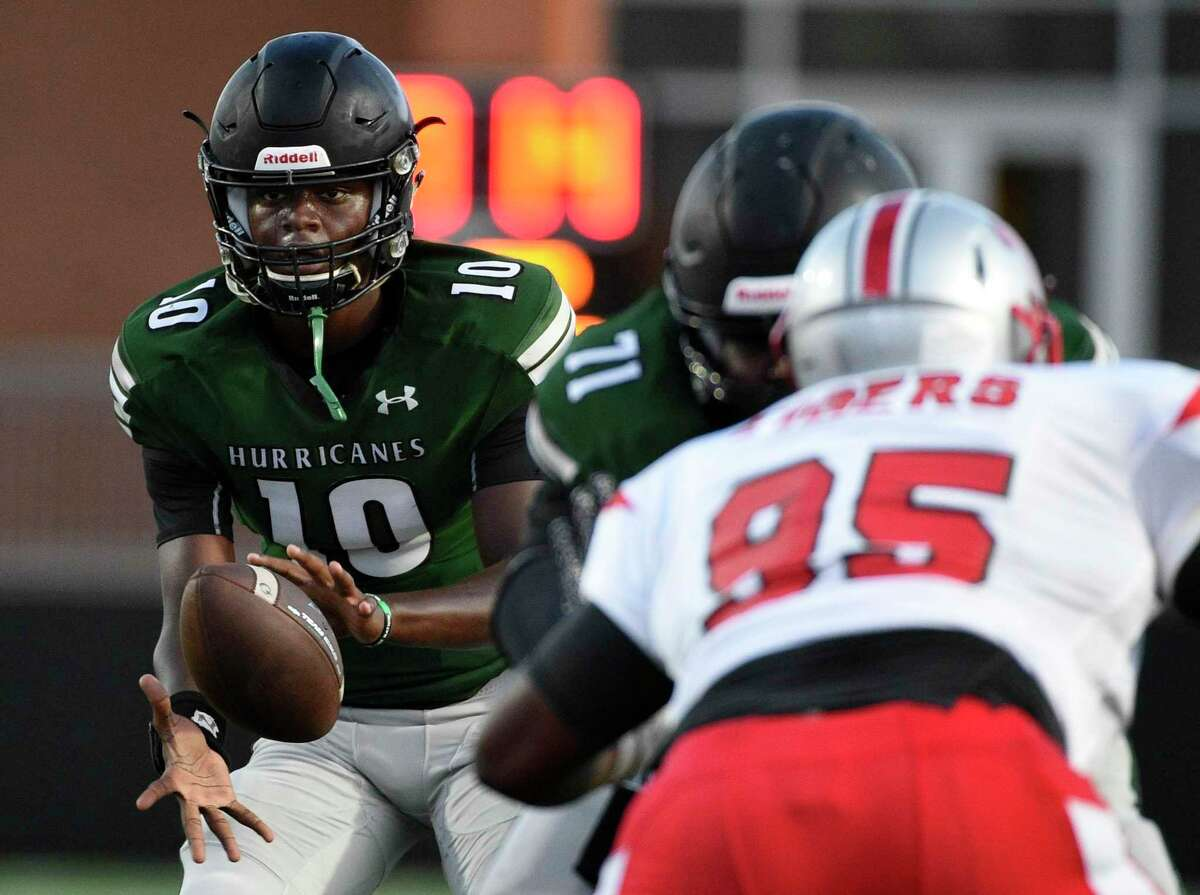 Hightower quarterback Jakolby Longino (10) takes the snap during the first half of a high school football game against Travis in August 2019. The University Interscholastic League announced that Sept. 7 would mark the official start of practices for Class 6A and 5A schools.