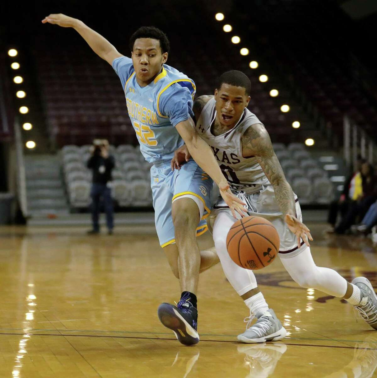 Southern University Jaguars guard Jayden Saddler (32) guards Texas Southern Tigers guard Tyrik Armstrong (20) while he drives to the basket during the second half of a SWAC tournament quarterfinal game at TSU's HPE Arena, Tuesday, March 12, 2019, in Houston.