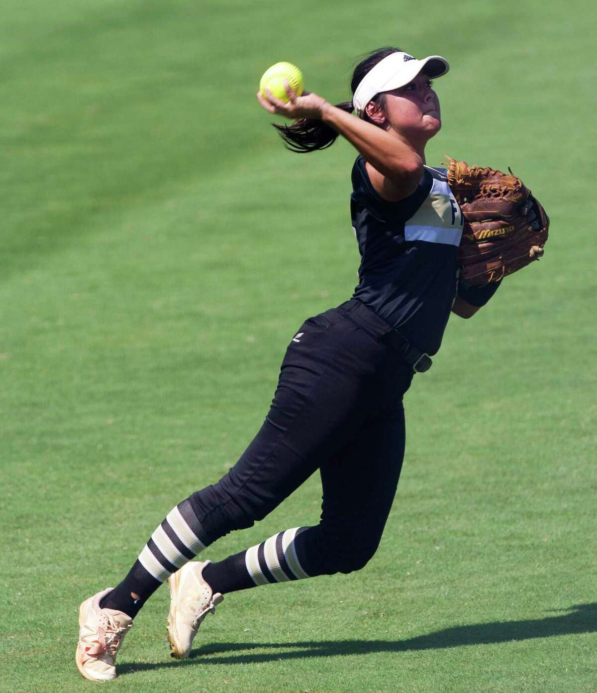Foster left fielder Ciarra Mata (9) throws toward the infield as she tries to throw out Caleigh Cross #23 of Forney as he advances to second in the fifth inning of the Class 5A state championship game during the UIL State Softball Championships at Red & Charline McCombs Field on Saturday, June 2, 2018, in Austin.