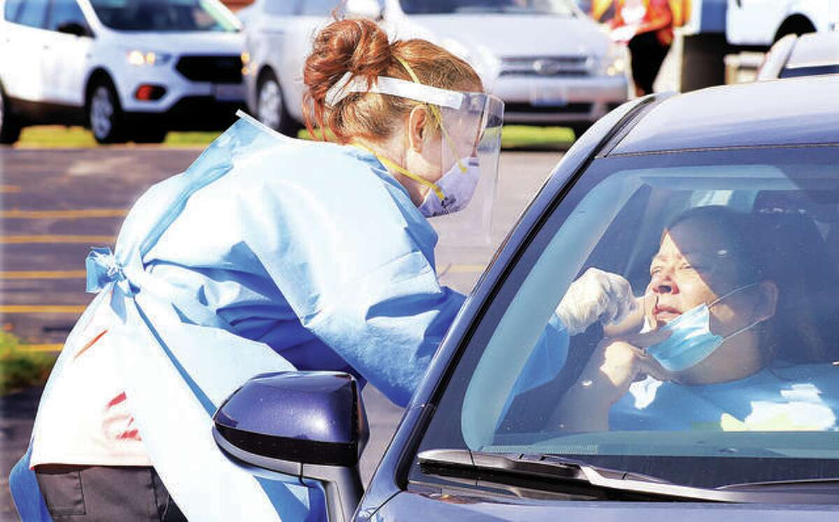 People began lining up as early as 7 a.m. July 14 for the 9 a.m. start of drive-up testing for COVID-19 behind the Godfrey Village Hall. Hundreds of people were tested for the virus by the Madison County Health Department.