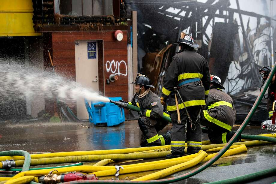 Firefighters battle a five-alarm structure fire in the South of Market neighborhood in San Francisco, Calif. on Tuesday, July 28, 2020. Photo: Stephen Lam / Special To The Chronicle