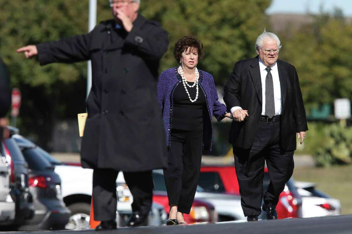 Pastor John Hagee and his wife, Diana, arrive for Charline McCombs' funeral services at Alamo Heights United Methodist Church in December 2019. Hagee and his son, Matthew, have sued city, county and Metro Health officials over an order to keep schools closed through Labor Day.