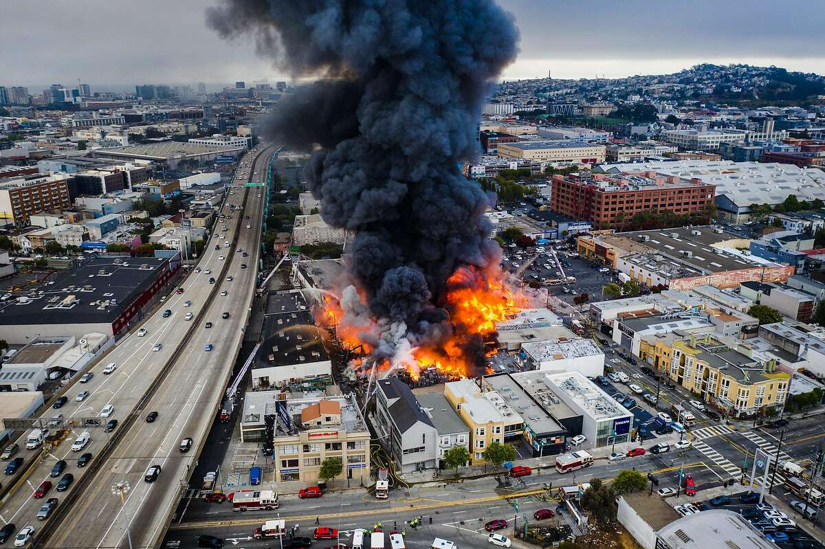 A large structure fire spread to multiple buildings near 13th and Shotwell streets on Tuesday, July 28, 2020 in San Francisco, Calif.
