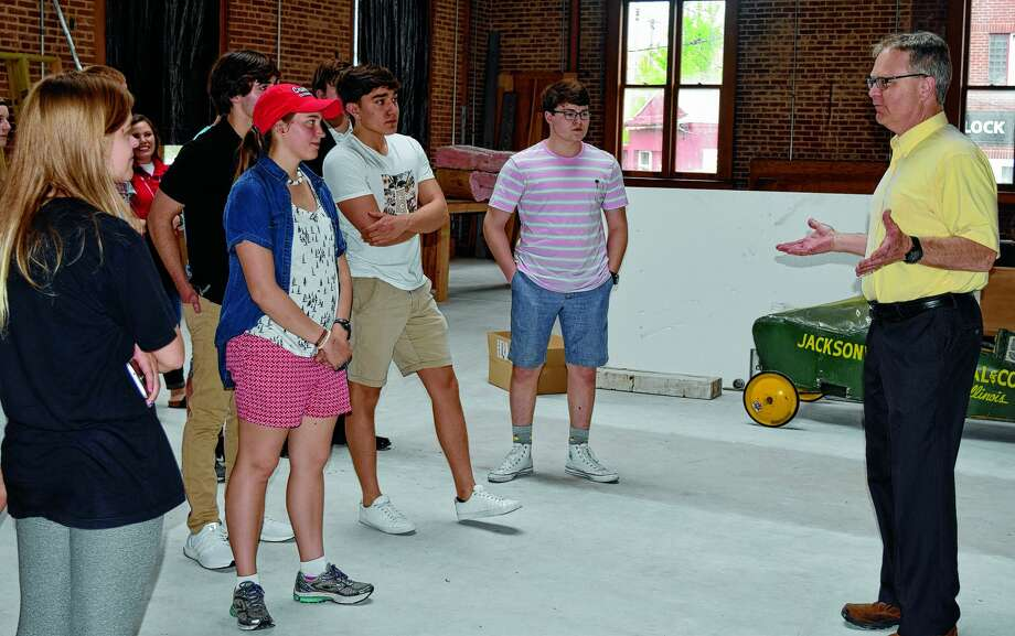 David Blanchette (right) shows students from Jacksonville High School's Advanced Placement history program the interior of Jacksonville's old post office during a tour in May 2019. The building is being turned into a museum. Photo: Journal-Courier
