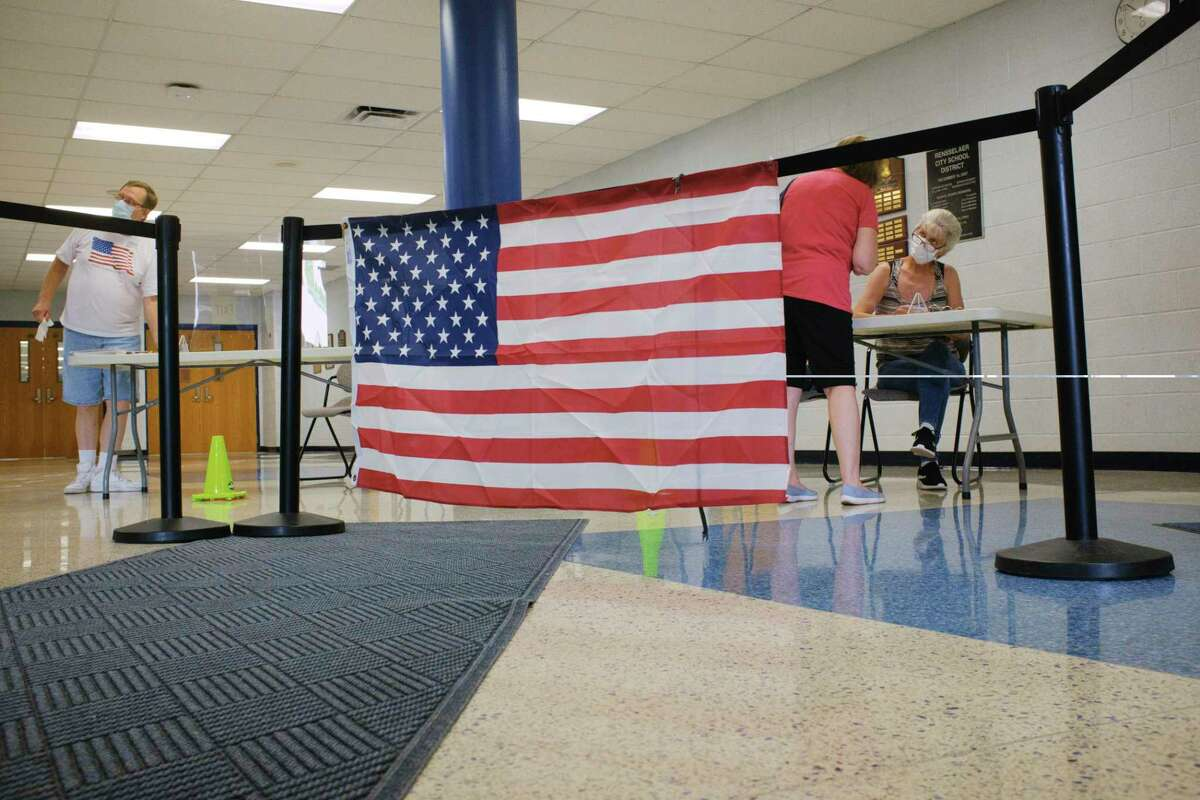 Election inspectors work with voters at the Rensselaer School Campus during the revote on Rensselaer City School District budget on Tuesday, July 28, 2020, in Rensselaer, N.Y. (Paul Buckowski/Times Union)