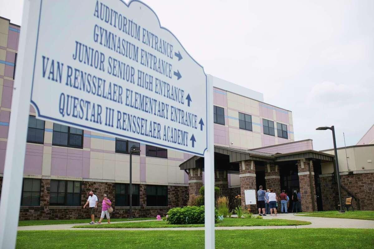 Voters wait in line outside the Rensselaer School Campus during the revote on Rensselaer City School District budget on Tuesday, July 28, 2020, in Rensselaer, N.Y. (Paul Buckowski/Times Union)