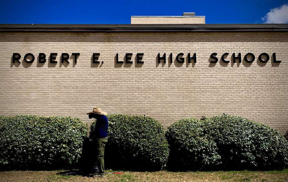 A groundskeeper works outside Robert E. Lee High School in Midland, Texas, July 27, 2020. Robert E. Lee High School was named after the Confederate Civil War General in 1961, during the civil rights movement. Community members are calling for a discussion about changing the name. Photo Credit: The Oilfield Photographer, Inc. Photo: The Oilfield Photographer Inc./The Oilfield Photographer, Inc. / © All Rights Reserved