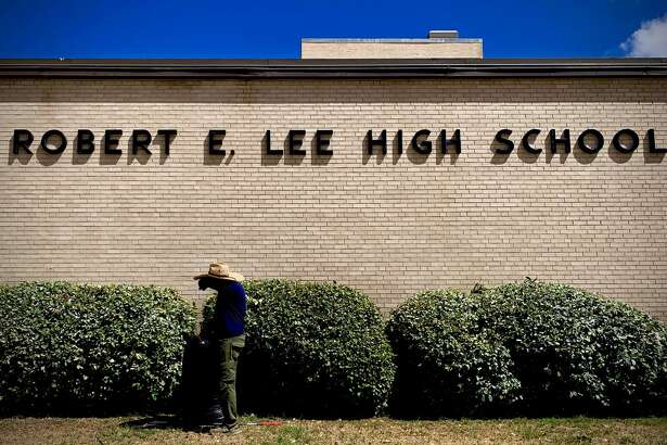 A groundskeeper works outside Robert E. Lee High School in Midland, Texas, July 27, 2020. Robert E. Lee High School was named after the Confederate Civil War General in 1961, during the civil rights movement. Community members are calling for a discussion about changing the name. Photo Credit: The Oilfield Photographer, Inc.