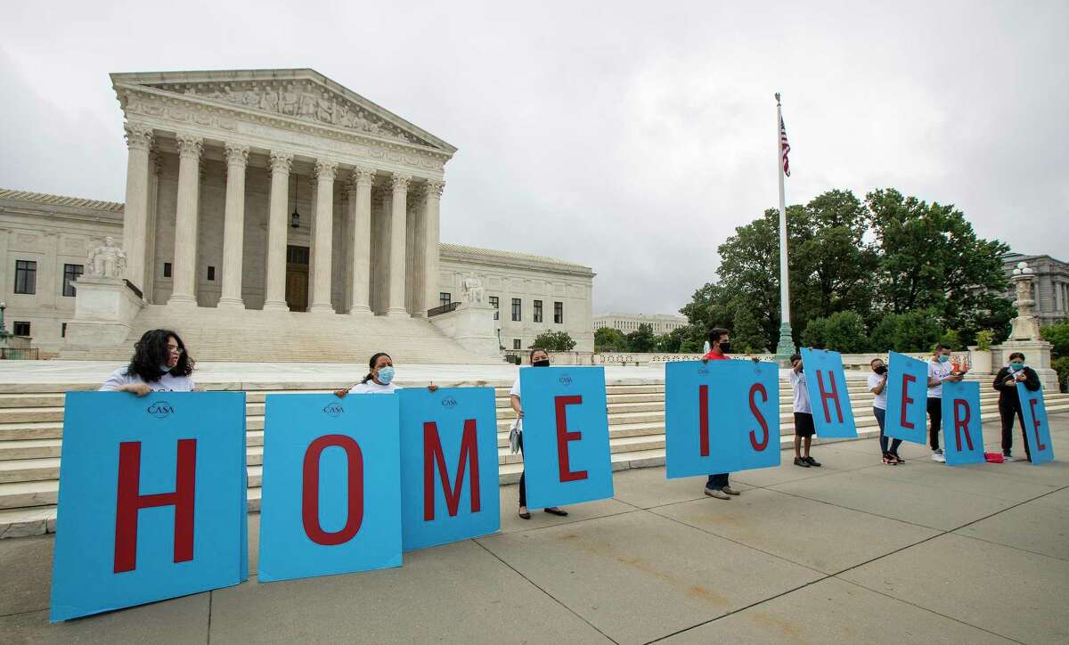 FILE - In this June 18, 2020, file photo, Deferred Action for Childhood Arrivals (DACA) students gather in front of the Supreme Court in Washington. (AP Photo/Manuel Balce Ceneta, File)