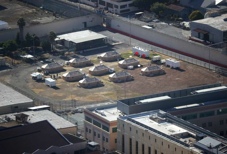 A view of a new emergency care facility that was erected to treat inmates infected with COVID-19 at San Quentin State Prison on July 08, 2020 in San Quentin, California. Over 1,400 inmates and staff at San Quentin State Prison have become infected with coronavirus COVID-19 after inmates from a Chino, California prison. Six inmates have died from the virus. An emergency care facility was erected on the baseball field to treat inmates suffering from one the largest outbreaks of COVID-19 in the nation. Photo: Justin Sullivan/Getty Images / 2020 Getty Images