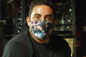 Working during the pandemic means wearing a mask when you're not on stage for Jared Freid.