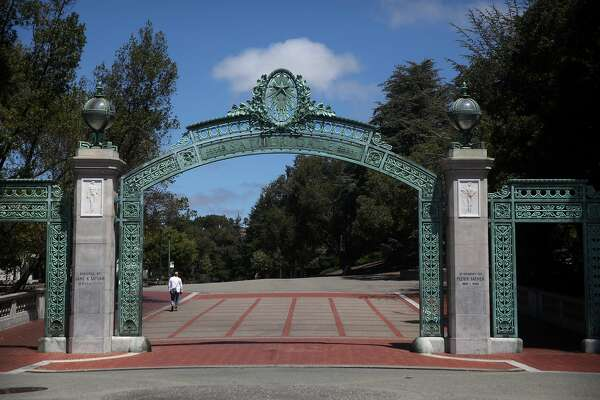 BERKELEY, CALIFORNIA - JULY 22: A lone pedestrian walks by Sather Gate on the U.C. Berkeley campus on July 22, 2020 in Berkeley, California. U.C. Berkeley announced plans on Tuesday to move to online education for the start of the school's fall semester due to the coronavirus COVID-19 pandemic. (Photo by Justin Sullivan/Getty Images)