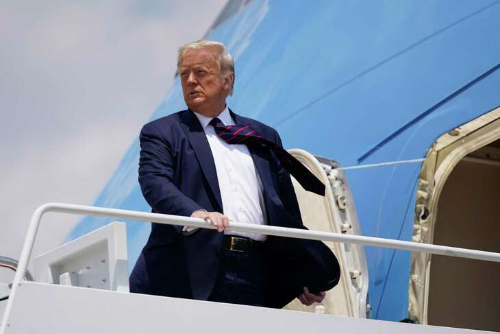 President Donald Trump boards Air Force One for a trip to visit Bioprocess Innovation Center at Fujifilm Diosynth Biotechnologies in Morrisville, N.C., on Monday, July 27, 2020. He scheduled to make a trip on Wednesday to Midland, Texas, July 29, 2020.